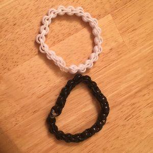 Jewelry - A black bracelet and a white bracelet